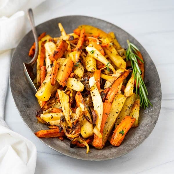 oven roasted parsnips and carrots on a platter.