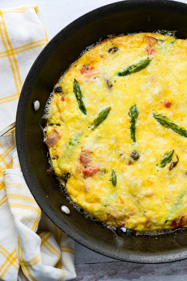 baked gluten free frittata in a skillet, hot from the oven makes a perfect breakfast for two.