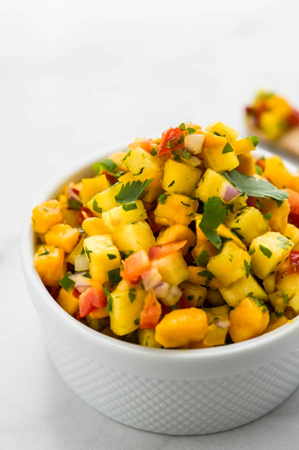 a closeup, backlit picture of the spicy mango salsa.