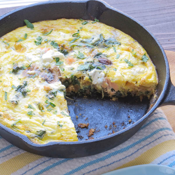 Salmon and Caramelized Onion Frittata missing a slice.