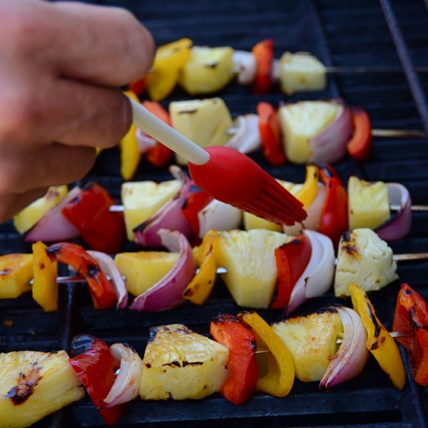 grilling vegetable kebabs and brushing with marinade.