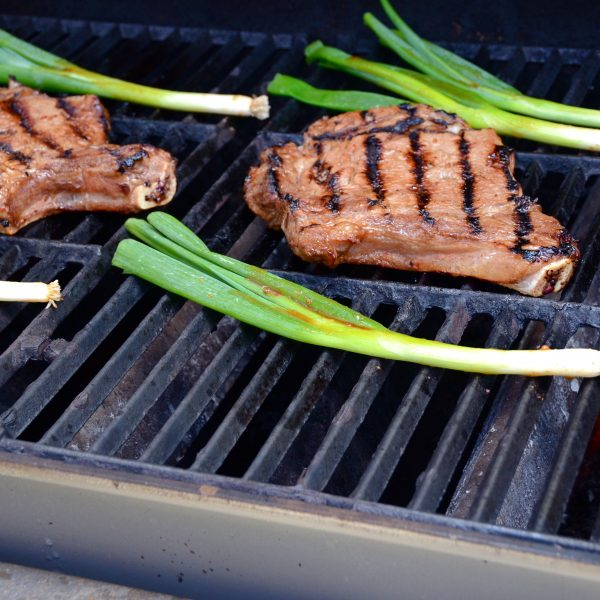 grilling steaks and onions.