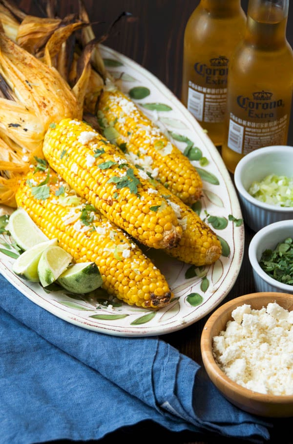 Grilled Chipotle Lime Corn with toppings.