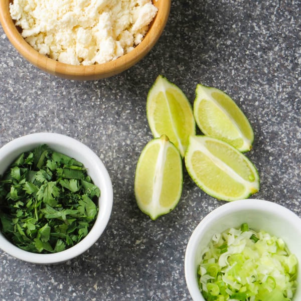 cotija, lime and cilantro for garnish.