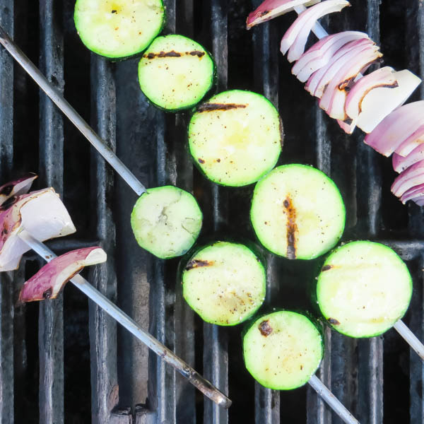grilling zucchini and onions.
