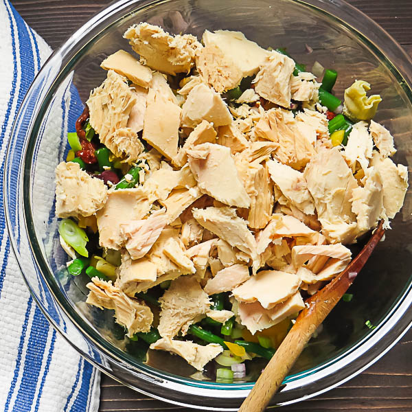 adding the tuna to Nicoise Farro Salad