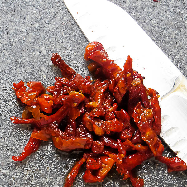 Chopping sun-dried tomatoes