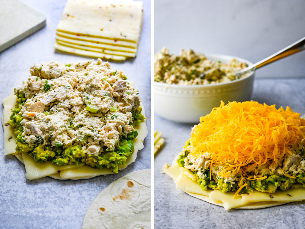 topping avocado with mexican tuna salad and cheese.