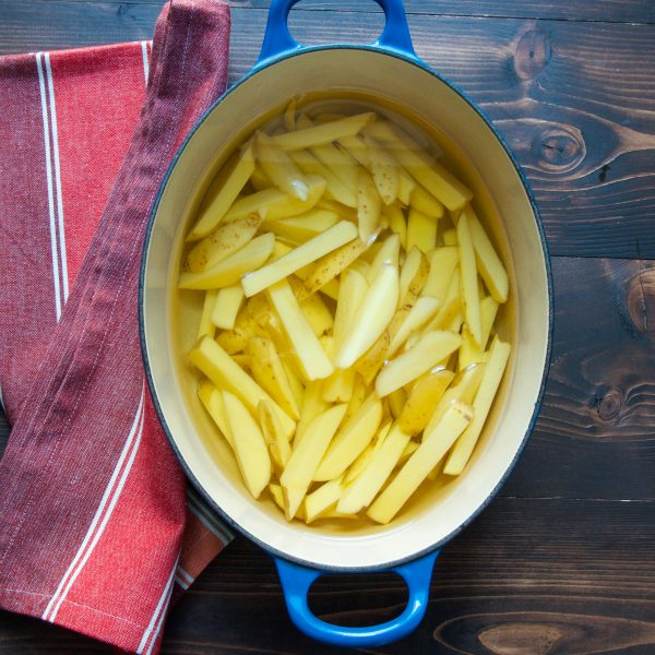 wfrench fries in cold oil