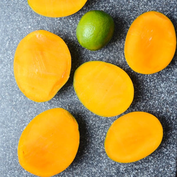 sliced mangoes and lime