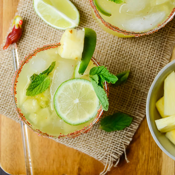 Pineapple Mint Mojito with swizzle stick