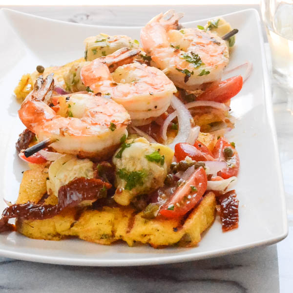 Italian-Style Grilled Shrimp and Polenta on a platter.