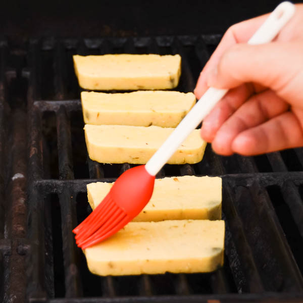 grilling polenta and brushing with oil