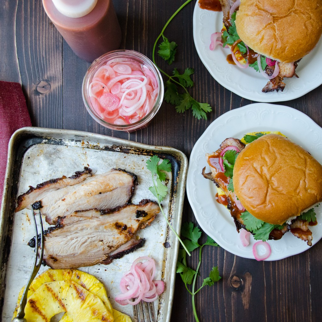 Tangy Barbecued Pork Sandwiches with condiments