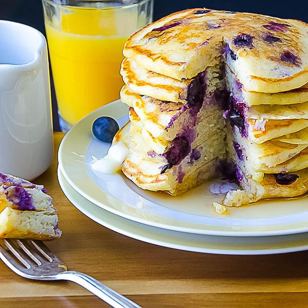 stack of Blueberry Lemon Cornmeal Pancakes with OJ