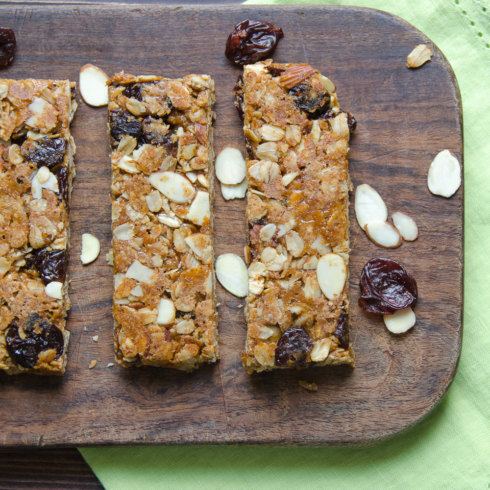 Cherry Almond Granola Bars on board with napkin