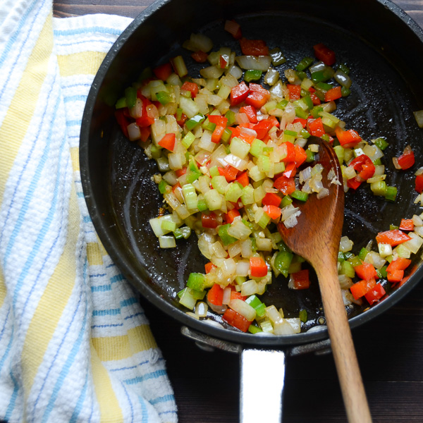 peppers, onions and celery in a pan