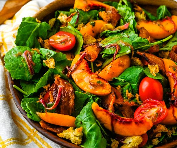 Juicy Peach and Baby Kale Salad with Bacon Dressing