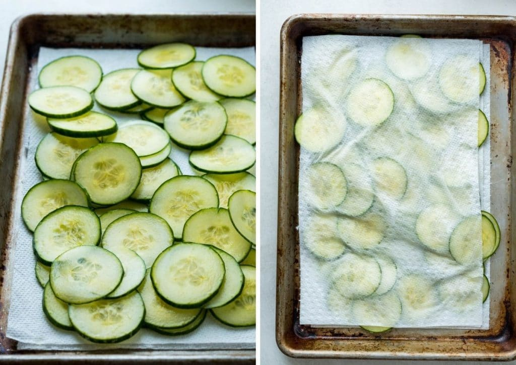 sliced cucumbers draining on paper towels.