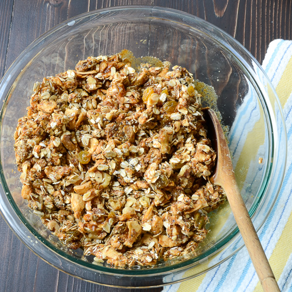 Apple Walnut Spice Granola in a bowl with spoon.