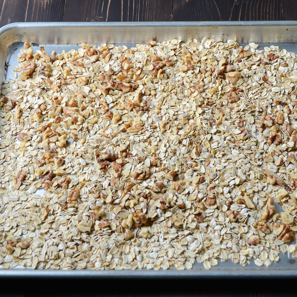 toasting grains on a baking sheet.