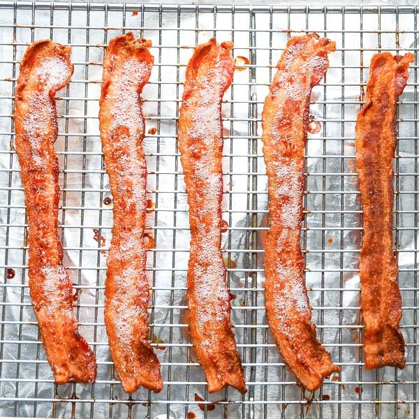 crisped bacon on a rack.