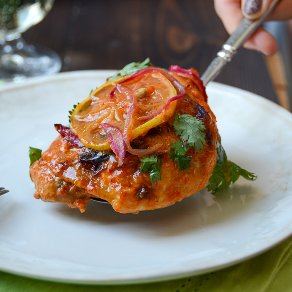 oven-roasted harissa chicken on a spoon.
