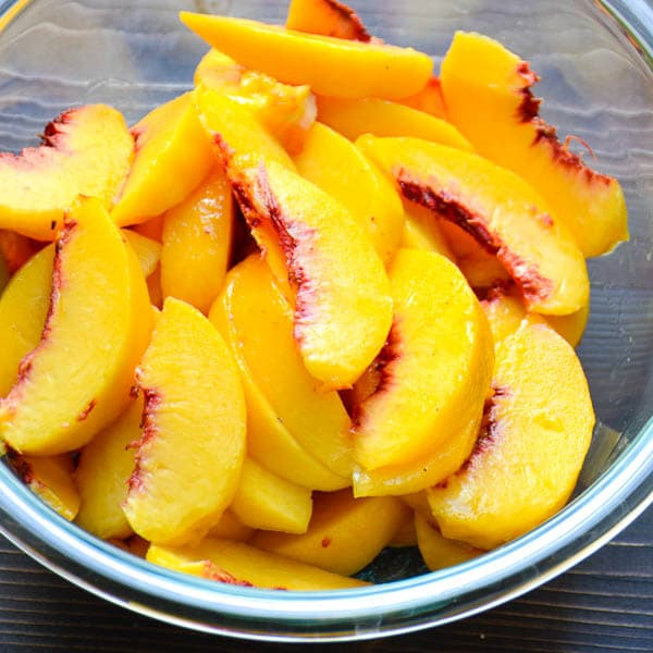 fresh peaches in a bowl.