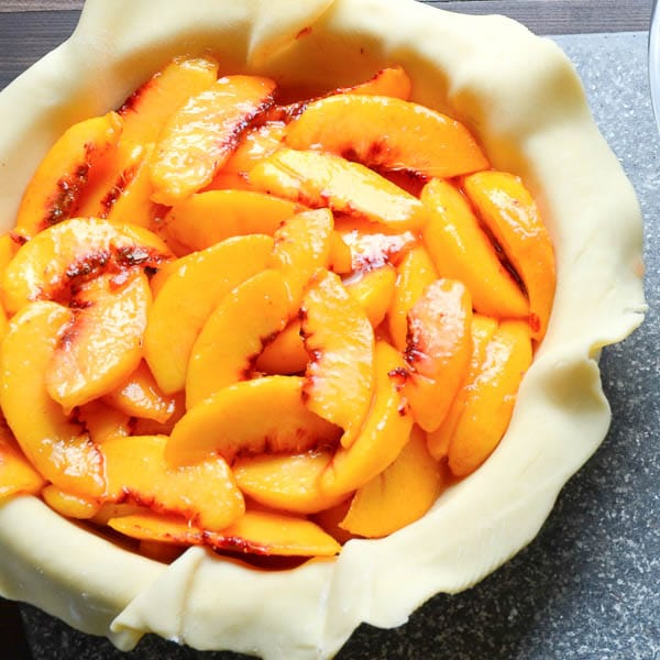 fresh peaches in pie crust.