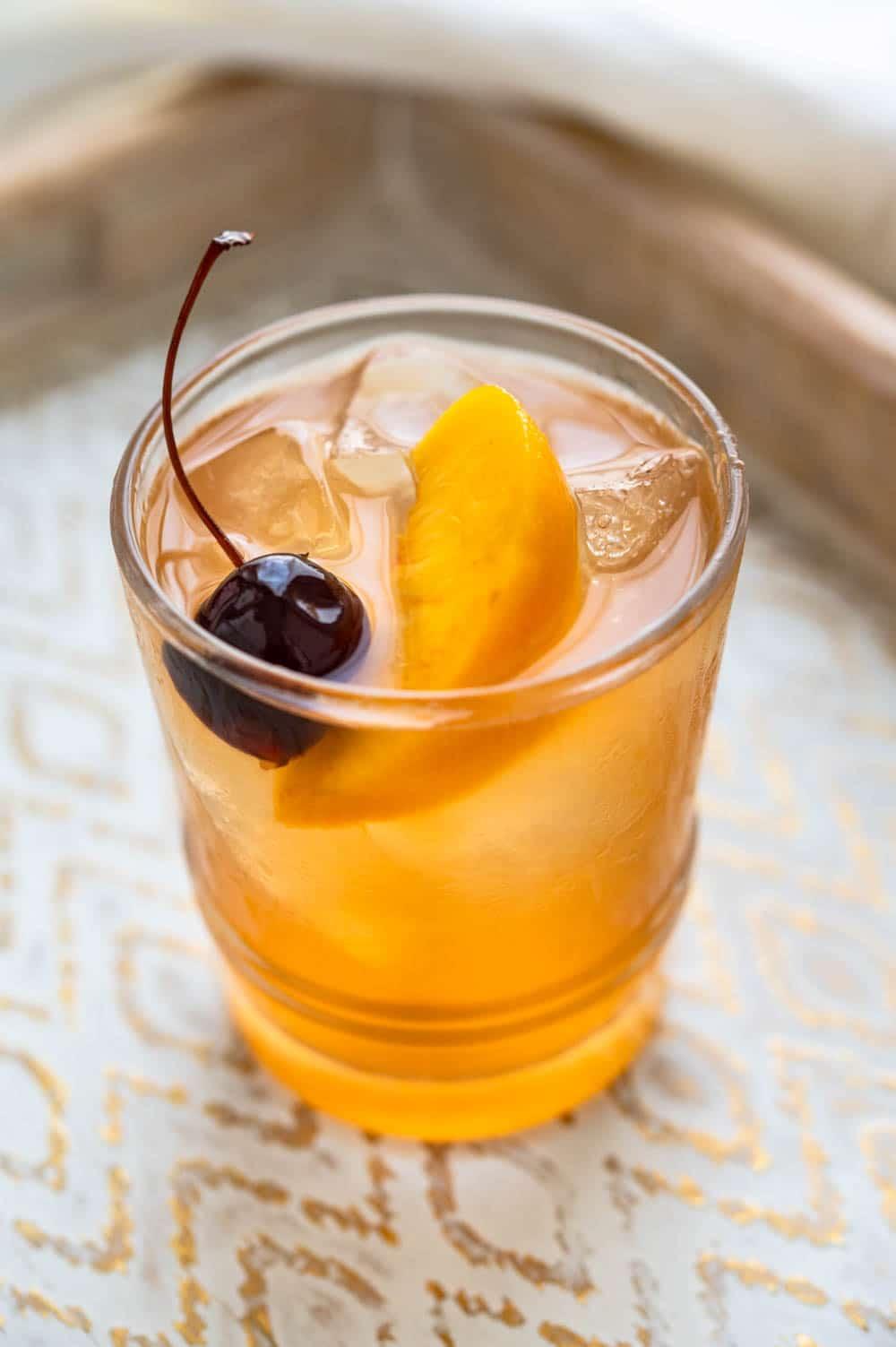 Fresh Peach Bourbon Sour in a cocktail glass.