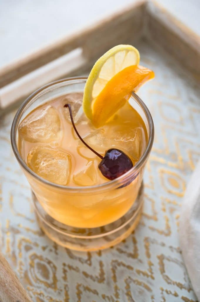 whiskey sour with fresh peach.