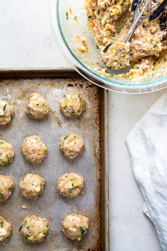 Forming meatballs with a cookie scoop.