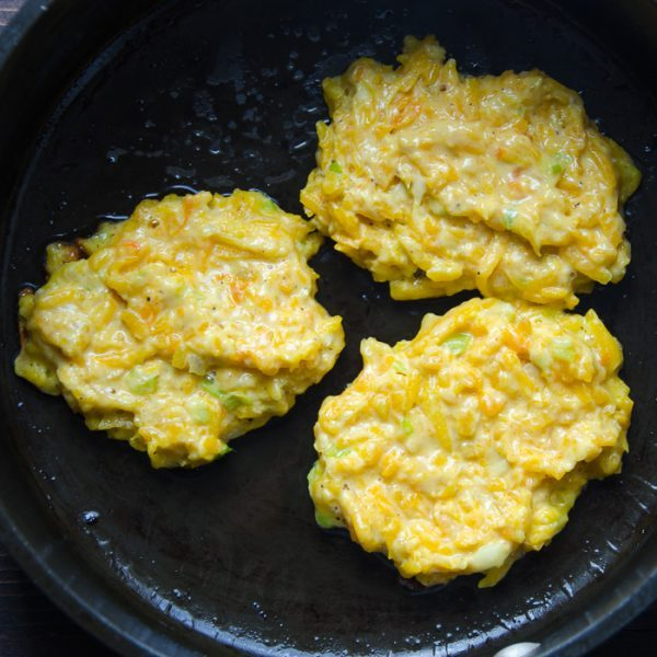 frying butternut fritters in cast iron skillet