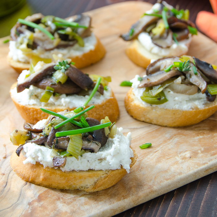 Wild Mushroom and Leek Crostini on a board.