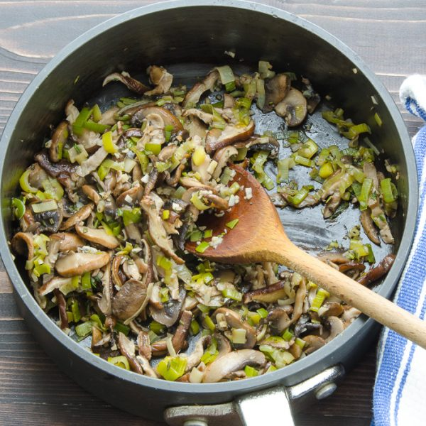 cooked mushrooms and leeks with spoon