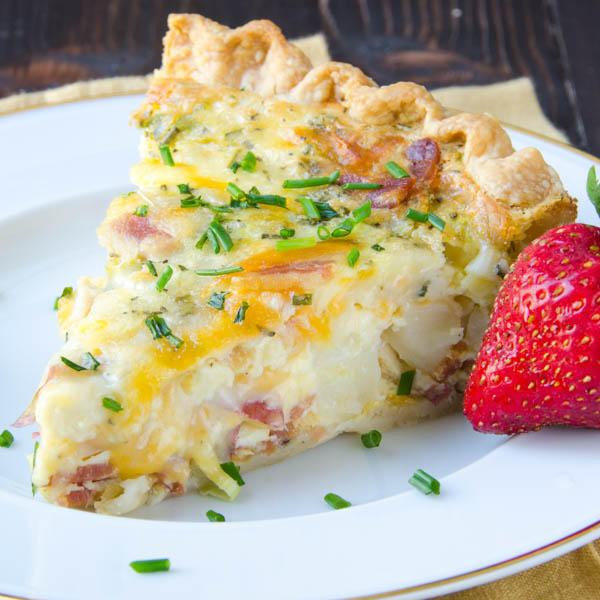 Slice of Loaded Baked Potato Quiche with strawberry