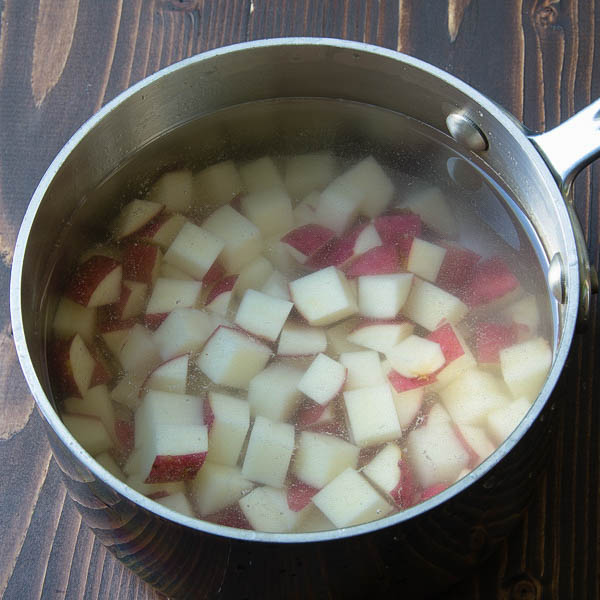 red skinned potatoes in a pot.