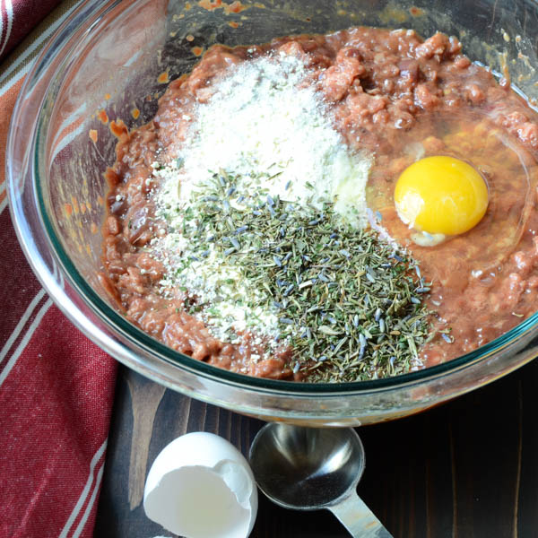 adding eggs and herbs to pate