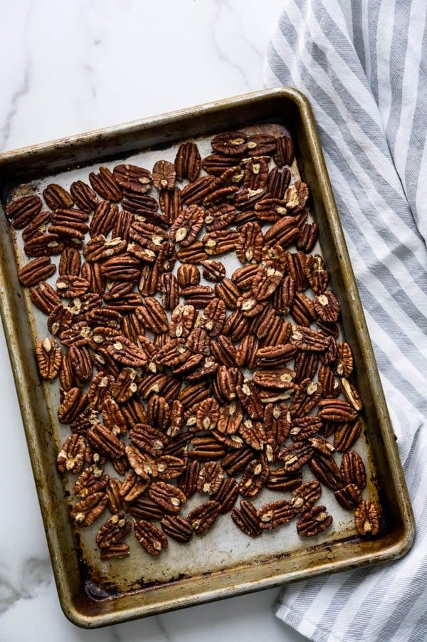toasting pecans on a sheet pan.