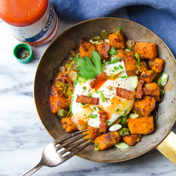 Sweet Potato and Bacon Hash with hot sauce.