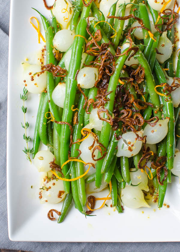 Overhead shot of Orange-Dijon Haricots Verts with Crispy Shallots.
