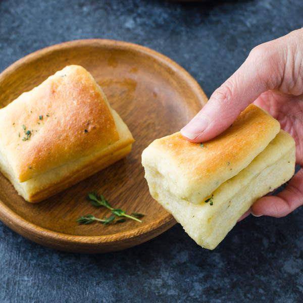 soft dinner rolls on a plate.