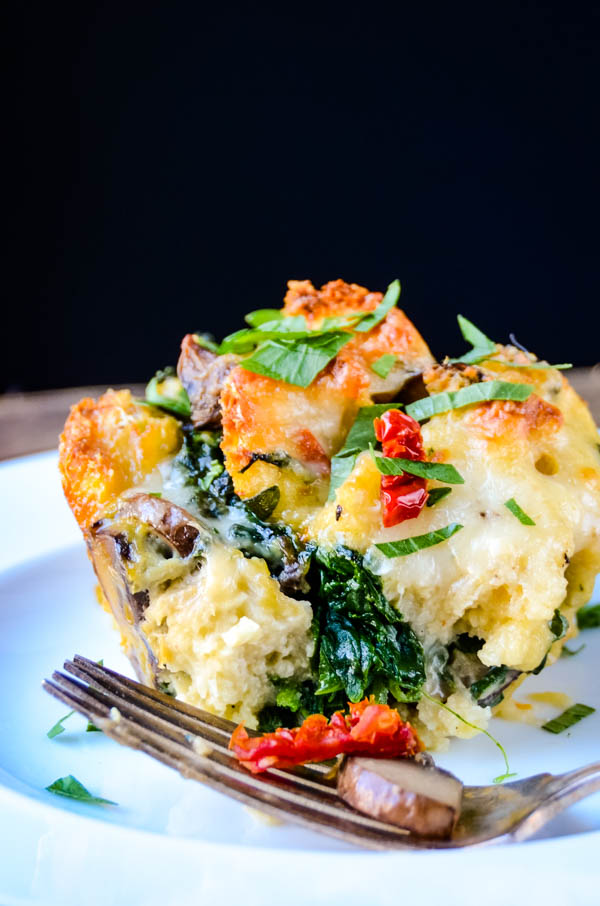 Spinach and Mushroom Breakfast Strata on a plate with a fork.