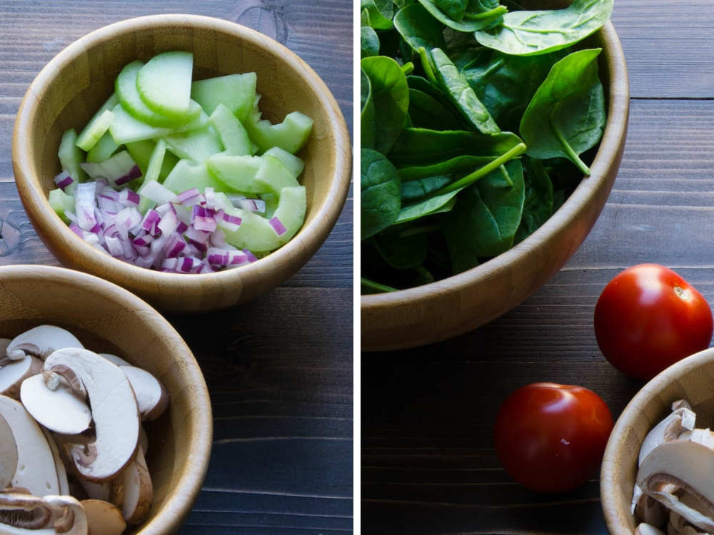 spinach bacon salad ingredients including tomatoes, onions, mushrooms and cucumbers.