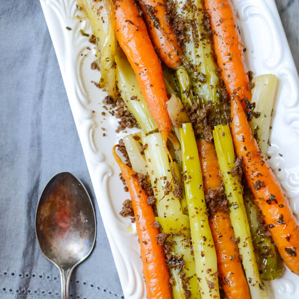 Braised Leeks and Carrots with Toasted Crumb on a napkin with spoon