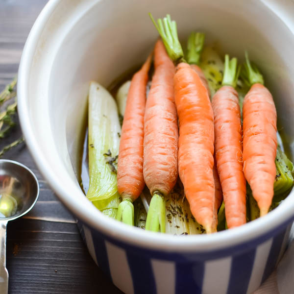 carrots and leeks in a casserole dish.
