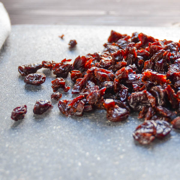 dried cherries on a cutting board.