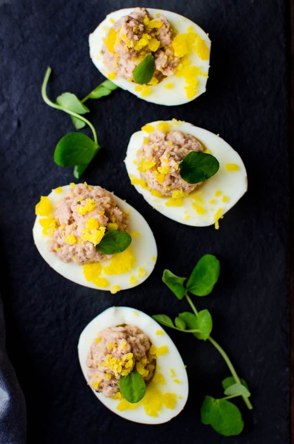 deviled ham stuffed eggs on a platter.