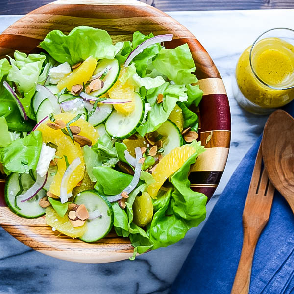 Simple Citrus Almond Salad on a marble board