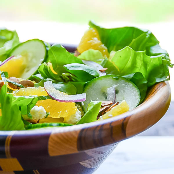 Simple Citrus Almond Salad in a wooden bowl